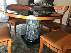 "Custom table with a ""tree bark"" base.  Beveled black glass top is removable.  3 side chairs, cushioned, and a curved bench"