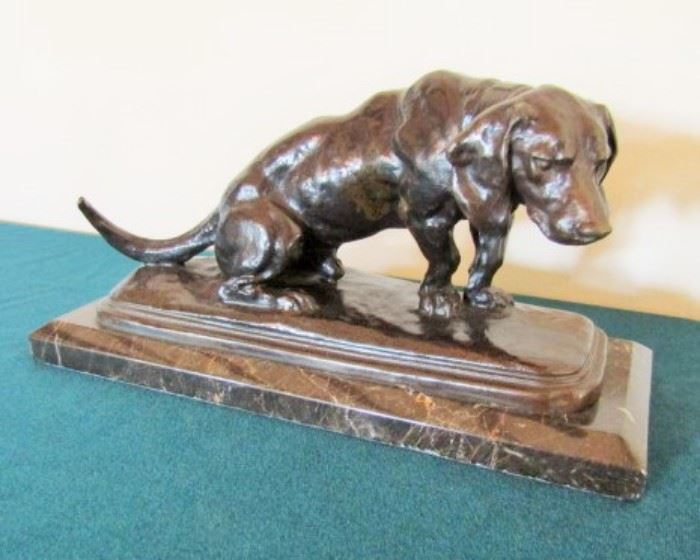 Bronze sculpture of dog