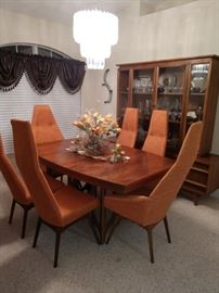 Mid-century Modern Danish Adrian Pearsall Tall Back Dining Chairs Set Of Six and table. This set is all original down to the burnt orange color! Will make a fantastic Christmas gift for that special someone who loves mid-modern furniture. We are asking only $2,500.00! A super buy!