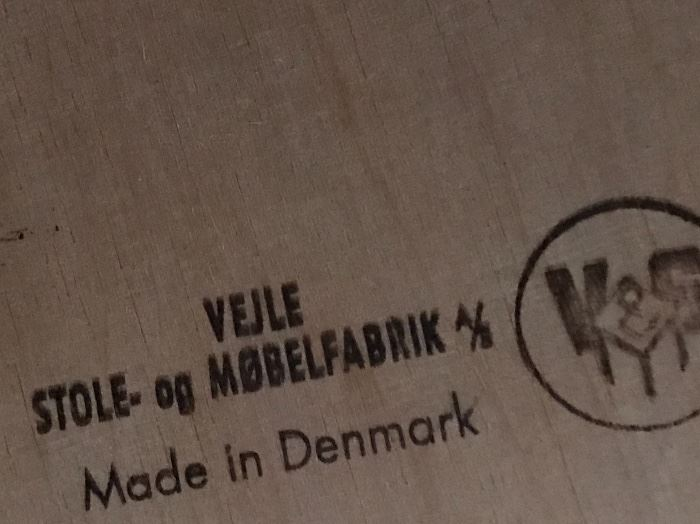 The stamp on the lower level mcm dining table!