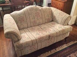 Camel back love seat