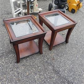 Nice wood and glass end tables. A few bumps and small bruises but could be touched up.