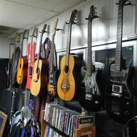 A nice collection of acoustic and electric guitars.
