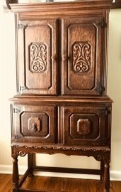 Antique oak carved china cupboard. Used. good condition. One piece of veneer missing. Can be restored. Carved front and a great deal of space.