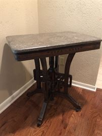 Victorian period Eastlake style parlor table with marble top, circa 1880.