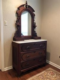 Victorian Period Renaissance Revival dresser with marble top and mirror with all original hardware, circa 1870.   This piece comes from a Corsicana family with a long history of collecting antique furniture.