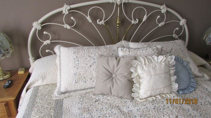 White and brass king headboard