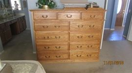 11 drawer tall chest of oak wood