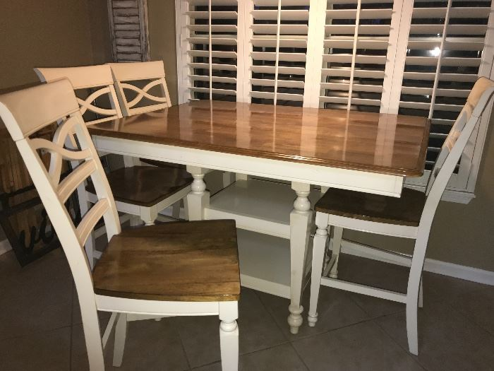 Wonderful high top table and 4 chairs, leaf stored under neath table, makes it a square - plus 4 chairs