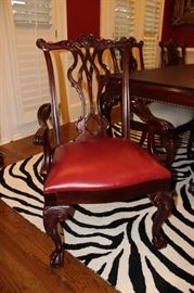 One of the mahogany arm chairs-- 10 in all--by Thomasville