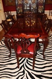 Beautiful banded mahogany table with two leaves and 10 chairs  by Thomasville--matching China Cabinet and Server also