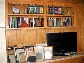 BOOKS PICTURE FRAMES AND FLAT SCREEN TV