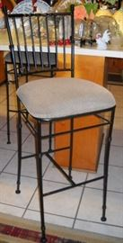 THERE ARE 2 OF THESE IRON BAR STOOLS