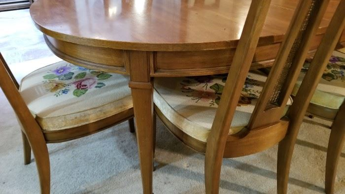 Dining room table - comes with 2 leaves and seats 8 people total. The chairs are a really beautiful hand-stitched floral design.