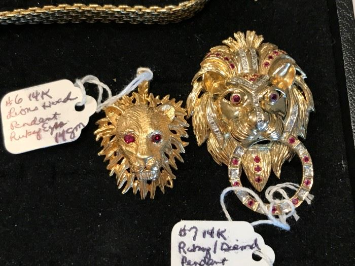 Pendant 14K gold lion head with ruby eyes, Brooch or pendant 14K gold Lion head with diamond and rubies.
