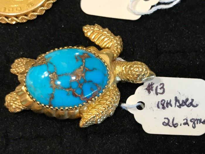 18K gold turtle with Turquoise center stone.