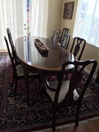 dining table with 2 leaves & 8 chairs.