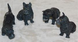 Four small Schnauzers, Pewter (?), Figures stamped on bottom  GERMANY. Approximately 3 to 4 inches long and 2 inches wide.