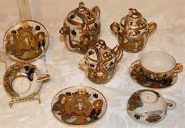 Japanese tea set from 1800's. 353. Seizan, red mark. Meiji period (1868 - 1912) 3 tea cups, 3 tea plates, 1 tea pot with dragon head & lid, 1 sugar pot with dragon head and lid 1 cream pot with dragon head and lid  http://www.gotheborg.com/marks/satsuma.shtml#seizan