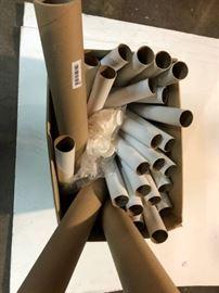 Box full of mailing tubes