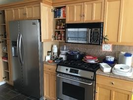 Kitchen Cabinets, Refrigerator, Range & Microwave