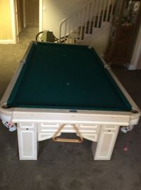 Brunswick Pool Table Excellent condition. With pool sticks, and balls.