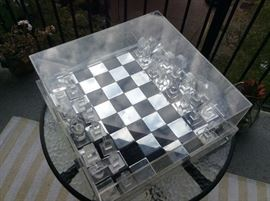 This is a rare find.  1970's Aluminum and Lucite chess set, small crack in cover.  Selling online for over $2,500