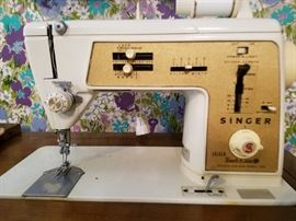 Singer sewing machine model 630 in wood cabinet
