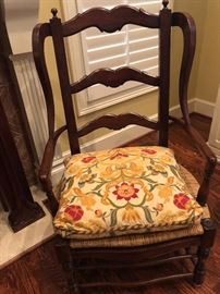 Dark wood, wide Accent Chair with rattan Woven seat.  One of two.