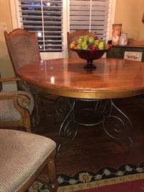 Rustic/Shabby Chic Dinette with additional leaf. Seats four or six comfortably. Solid Wood with metal scroll base. Set of four dining chairs.