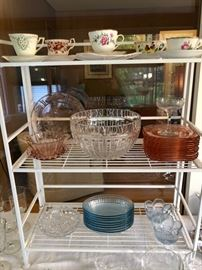 Pink depression glass, and tea cups and saucers.