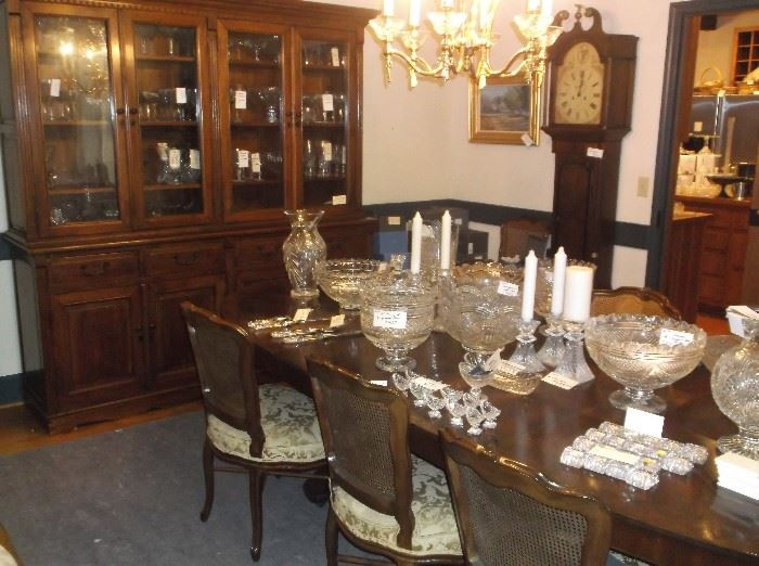Large breakfront, walnut dining table w/12 cane back chairs, and Waterford crystal
