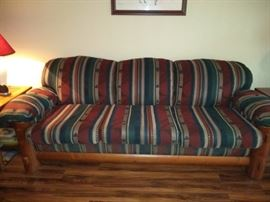 Nice log cabin style sofa with a southwestern flare