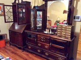 dresser with built in display cabinet and glass doors and mirror next to a lovely vintage secretary with claw feet, federal look and in great shape