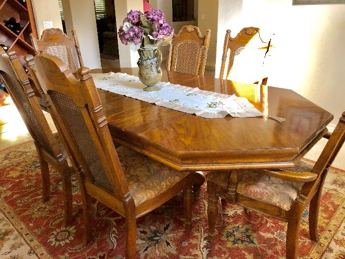 Dining room table with 6 upholstered chairs and protective pads