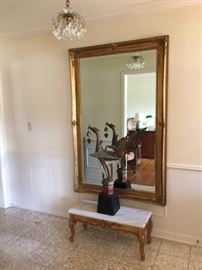 Entry Table, mirror, statue & small crystal light fixture