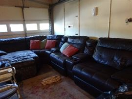 beautiful sectional with lounge recliner, 2 recliners, and 2 drink sections.