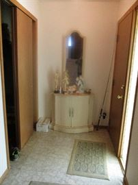Entryway with storage cabinet, figurines, etc.