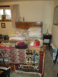 Double bed, weavings, vintage hats