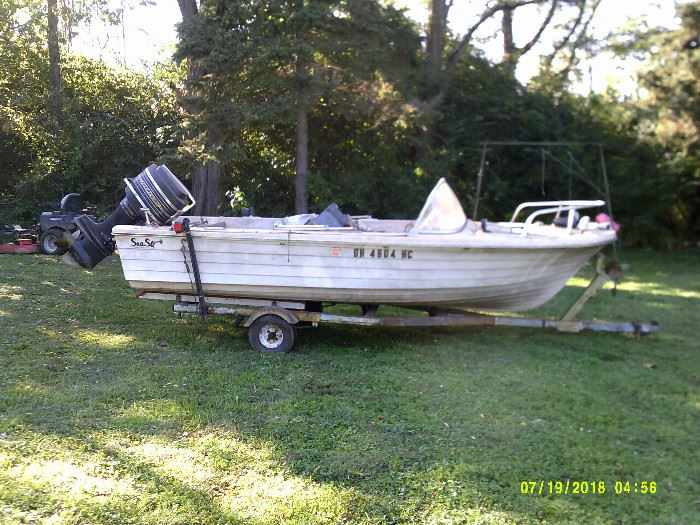 1967 14 ft Sea Star fiberglass boat with 65 hp outboard