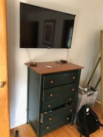 flat screen tv and small dresser