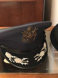 Lots of medals, uniform and caps