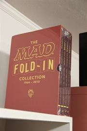 Some are sealed copies like this Mad Fold-in Collection.