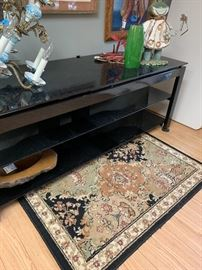 Large Black glass entertainment console.