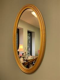 Beautiful and heavy gold mirror.