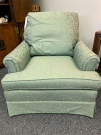 Pretty overstuffed occasional chair.