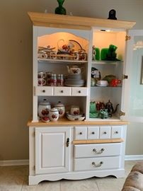 Kitchen hutch with lots of storage.