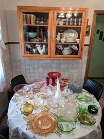 So many eras present here!  Vintage Pyrex, Bakelite, Disney mugs, depression and milk glass...