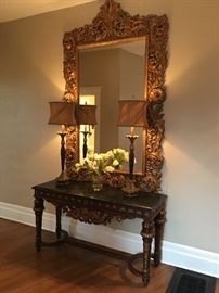 "Magnificent marble topped foyer table made in Italy with intricate baroque carvings. This unique piece is 5' long and 20"" deep.  The table top is 32"" off the floor. Retail $3200. Your price is $1400. It pairs beautifully with the baroque mirror! The mirror is 7'-7"" tall and 4'-6"" wide. The price of the mirror s $500."