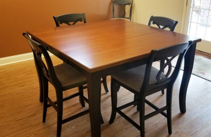 High top dining room table and six chairs in excellent condition